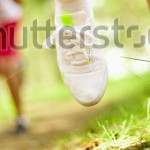 stock-photo-image-of-human-feet-in-sportshoes-running-down-grass-83690434